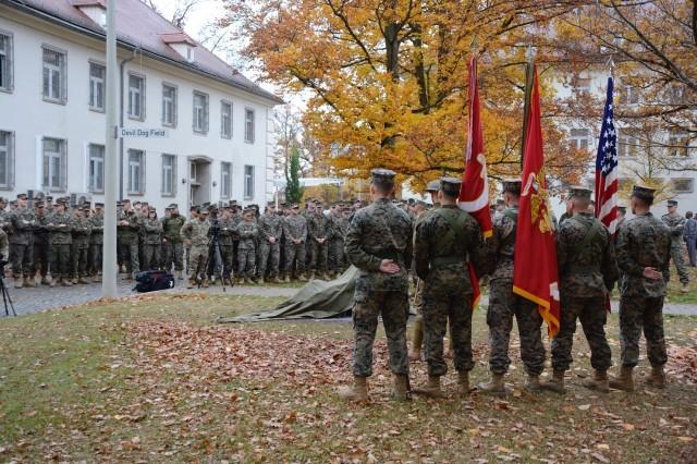 """Marines assembled on the MARFOREUR/AF parade ground witness the dedication of """"Devil Dog Field,"""" Nov. 8."""