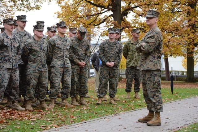 Maj. Gen. Russell A. Sanborn, commander, MARFOREUR/AF, addresses Marines assembled for the dedication of Devil Dog Field, Nov. 8.