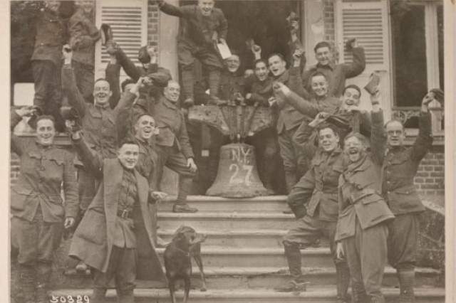 Soldiers of the New York National Guard's 27th Division celebrating the end of World War I following the Armistice on Nov. 11, 1918. According to Major General John O'Ryan, the commander of the division, this photo and others like it were staged in the days following the signing of the document that ended combat in the World War