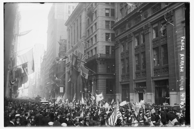 New York City residents throng the streets of the city on Nov. 11, 1918 as they celebrate the end of the fighting in World War I.