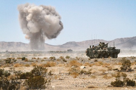 "A Stryker crew of Soldiers with the Pennsylvania Army National Guard begin their patrol, headed deep in to the ""box,"" a simulated battlefield at the National Training Center, Fort Irwin, Calif., Aug. 15, 2018."