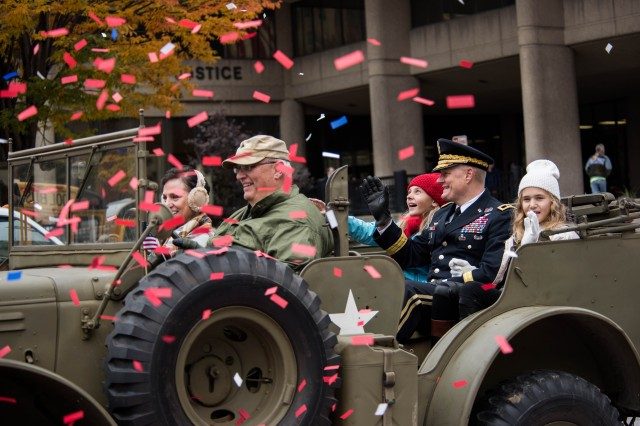 Local and area veterans enjoy a ticker-tape Veterans Day parade in their honor in downtown Louisville, Kentucky, Nov. 9, 2018.