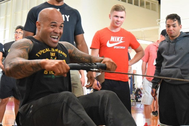 SCHOFIELD BARRACKS, Hawaii - U.S. Army Veteran Laumatalelei Pelesasa competes in the 2018 Pacific Regional Trials rowing finals, Nov. 9, at the Family Gym. Indoor rowing is a new adaptive reconditioning activity at this year's Trials that offers both strength training and cardiovascular benefits for all body types and fitness levels. About 100 wounded, ill, or injured active duty Soldiers and Veterans participate in a series of adaptive sporting events at Schofield Barracks, Hawaii, Nov. 6-16, hosted by the Tripler Army Medical Center's Warrior Transition Battalion and Regional Health Command - Pacific.