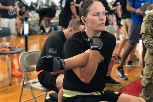 Maj. Kristina Carney, assigned to the Warrior Transition Battalion at Joint Base Lewis-McChord, competes in the 2018 Pacific Regional Trials rowing finals, Nov. 9, at the Family Gym. Indoor rowing is a new adaptive reconditioning activity at this year's Trials that offers both strength training and cardiovascular benefits for all body types and fitness levels. About 100 wounded, ill, or injured active duty Soldiers and Veterans from the U.S. Army Regional Health Commands in the Pacific, Atlantic, and Central regions participate in a series of adaptive sporting events at Schofield Barracks, Hawaii, Nov. 6-16, hosted by the Tripler Army Medical Center's Warrior Transition Battalion and Regional Health Command - Pacific.