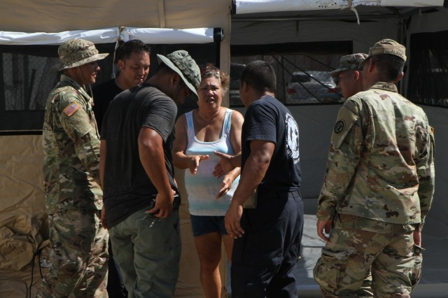 Ana Aldan, center, shakes hands with Department of Fire and Emergency Management Services personnel and Soldier with the 797th Engineer Company (Vertical), 9th Mission Support Command, currently assigned to Joint Task Group-Saipan, Task Force-West, after they set up a temporary shelter for her on her house lot in Koblerville, Saipan, Commonwealth of the Northern Mariana Islands, Nov. 9. The tents are provided by FEMA. Service members from Joint Region Marianas and other units from within U.S. Indo-Pacific Command assigned to Task Force-West are providing Department of Defense support to the CNMI's civil and local officials as part of the FEMA-supported Super Typhoon Yutu recovery efforts.