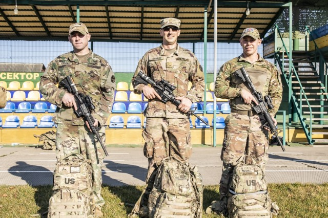 From left, Maj. Colby Tippens, 2Lt. Ran Pressley and 1Lt Chase Mitchell pose for a picture. Top three finishers of the Veterans Da Ruck March held at the International Peacekeeping ands Security Center, Ukraine, Nov. 11.