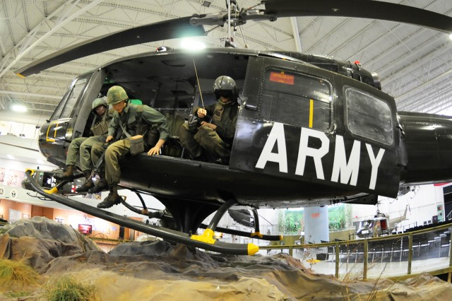 The UH-1D Huey helicopter sits as a centerpiece in the U.S. Army Aviation Museum.