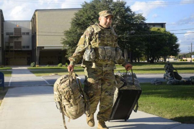 Deployers from Headquarters Company, 89th Military Police Brigade, unload their equipment into their temporary lodging quarters at Lackland Air Force Base, Texas, in support of Operation Faithful Patriot, Oct. 29, 2018. The Army released a new directive that defines deployability and the requirements Soldiers must meet to become deployable.