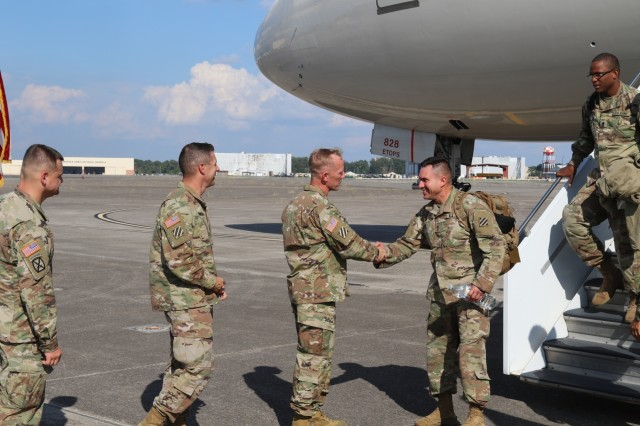 Command Sgt. Major Daniel Hendrex and Col. (P) Andy Hilmes greet Raider Brigade Soldiers arriving at Hunter Army Airfield after completing a nine-month tour in Korea supporting the 2nd Infantry Division.