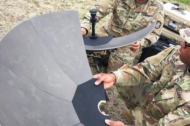 Soldiers work with an Expedient Satellite Communications System at Fort Belvoir, Virginia.