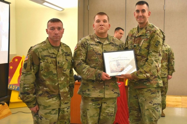 Staff Sgt. Joseph Butler from Charlie Battery, 2-1 Air Defense Artillery Battalion, received top honors and was recognized as the PMG honor graduate.