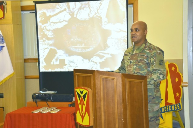 Guest speaker, Command Sgt. Maj. Randy B. Gray, 30th Air Defense Artillery Brigade command sergeant major, from Fort Sill, Oklahoma, challenged the new graduates to live up to the standards of a Patriot Master Gunner by becoming system experts and a better trainers.