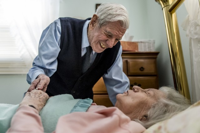 """Retired Sgt. Maj. Raymond Moran, affectionately known as the """"Old Soldier,"""" smiles at his wife before she goes for a nap at home in Odenton, Md., Jan. 18, 2018. Raymond and Barbara have been married 65 years, the same number of years Moran spent in service to the U.S. Army and Army Reserve as an enlisted Soldier and as a Department of the Army civilian. Moran served in Korea, Vietnam, Japan, Cambodia and Desert Storm."""