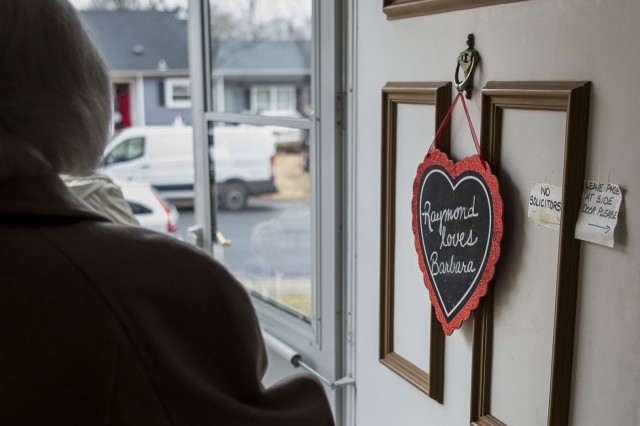 """A sign reading """"Raymond loves Barbara"""" hangs on their front door as Barbara Moran heads out for a hair appointment before celebrating their 65th wedding anniversary married to retired Sgt. Maj. Raymond Moran, affectionately known as the """"Old Soldier,"""" in Odenton, Md., Feb. 10, 2018. Their wedding anniversary matches the same number of years Moran spent in service to the U.S. Army and Army Reserve as an enlisted Soldier and as a Department of the Army civilian. Moran served in Korea, Vietnam, Japan, Cambodia and Desert Storm."""