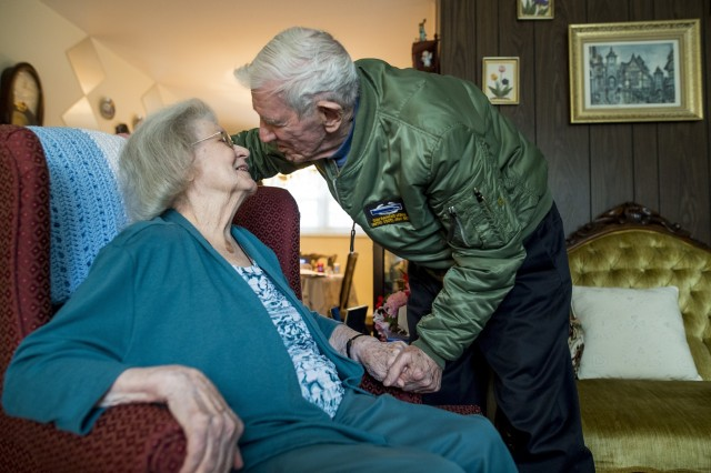 """Retired Sgt. Maj. Raymond Moran, affectionately known as the """"Old Soldier,"""" leans in to kiss his wife, Barbara, of 65 years marriage at their home in Odenton, Md., Feb. 11, 2018. The Morans officially celebrate their wedding anniversary on Valentine's Day. They were married Feb. 14, 1953. Raymond is originally from Latrobe, Pennsylvania, and Barbara is from Slovan, Pennsylvania. With this milestone, their years of marriage match the same number of years Moran committed to service in the Army and Army Reserve. Raymond enlisted in 1948, and served in Korea, Vietnam, Japan, Cambodia and during Desert Storm. He spent 30 years on active duty and 35 years as a civilian recruiter in the U.S. Army Reserve."""