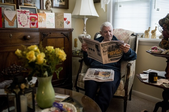 """Retired Sgt. Maj. Raymond Moran, affectionately known as the """"Old Soldier,"""" catches up on Army news as part of his morning routine at home in Odenton, Md, Feb. 22, 2018. Moran devoted 65 years of service both as an enlisted Soldier and as a Department of the Army civilian in the U.S. Army and Army Reserve. He served in Korea, Vietnam, Japan, Cambodia and during Desert Storm."""