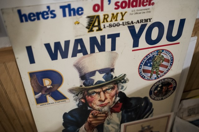"""A U.S. Army recruiting poster leans against the wall in the basement of Retired Sgt. Maj. Raymond Moran's home in Odenton, Md., Feb. 22, 2018. Moran is affectionately known as the """"Old Soldier."""" He spent 65 years in service to the Army, both as an enlisted Soldier and as a civilian recruiter, having served in Korea, Vietnam, Japan, Cambodia and during Desert Storm."""
