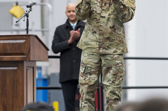 """Command Sgt. Maj. Gregory S. McNeill, outgoing command sergeant major of the First Recruiting Brigade, shows gratitude to tetired Sgt. Maj. Raymond Moran, affectionately known as the """"Old Soldier,"""" during McNeill's farewell ceremony on Fort Meade, Md., March 9, 2018. Moran had been a friend and mentor to McNeill and served as the recruiting brigade's sergeant major before retiring. Moran devoted 65 years of total service as an enlisted Soldier and as a Department of the Army civilian in the U.S. Army and Army Reserve. He served in Korea, Vietnam, Japan, Cambodia and during Desert Storm."""