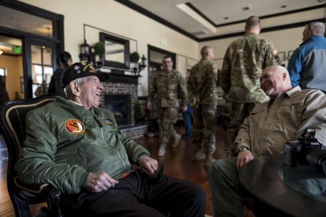 """Sgt. Maj. (Ret.) Raymond Moran, affectionately known as the """"Old Soldier,"""" catches up with a friend during a welcome luncheon after a military ceremony hosted by the First Recruiting Brigade on Fort Meade, Md., March 9, 2018. Moran used to be the brigade's sergeant major and devoted 65 years of service as an enlisted Soldier and as a Department of the Army civilian in the U.S. Army and Army Reserve. He served in Korea, Vietnam, Japan, Cambodia and during Desert Storm."""