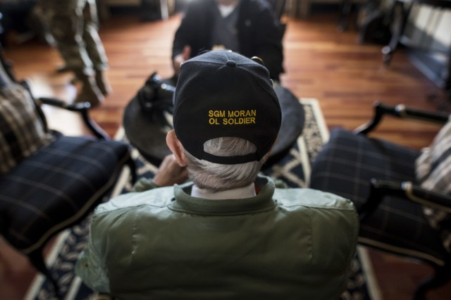 """Retired Sgt. Maj. Raymond Moran, affectionately known as the """"Old Soldier,"""" catches up friends during a welcome luncheon after a military ceremony hosted by the First Recruiting Brigade on Fort Meade, Md., March 9, 2018. Moran used to be the brigade's sergeant major and devoted 65 years of service as an enlisted Soldier and as a Department of the Army civilian in the U.S. Army and Army Reserve. He served in Korea, Vietnam, Japan, Cambodia and during Desert Storm."""