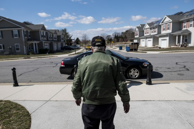 """Retired Sgt. Maj. Raymond Moran, affectionately known as the """"Old Soldier,"""" walks back to his son's car toward Moran Street, which was named after him on Fort Meade, Md., years previously. Moran used to be the First Recruiting Brigade's sergeant major on post and devoted 65 years of service as an enlisted Soldier and as a Department of the Army civilian in the U.S. Army and Army Reserve. He served in Korea, Vietnam, Japan, Cambodia and during Desert Storm."""