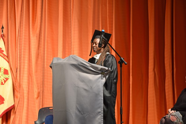 WIESBADEN, Germany -- Student speaker Cynthia Forsyth delivers remarks during a graduate recognition ceremony Nov. 14, 2018, in the Tony Bass Theater. Forsyth was recognized for receiving her master's degree.