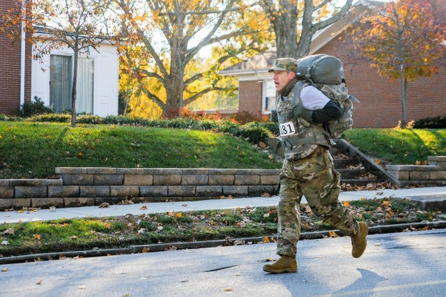 Chaplain (Capt.) Joshua Stine with the 103rd Brigade Support Battalion rucks through a 6.6 km run/walk/ruck in Harrodsburg, Ky., Nov. 10, 2018. Soldiers with the 103rd worked with the local community to host a 76th Bataan Memorial Day event in the city in honor of the Harrodsburg Tankers.