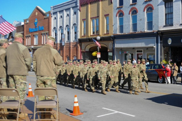 Soldiers with the 103rd Brigade Support Battalion march in a Veterans Day parade in Harrodsburg, Ky., Nov. 10, 2018. The unit worked with community leaders to host a 76th Bataan Memorial Day event honoring the Harrodsburg Tankers.