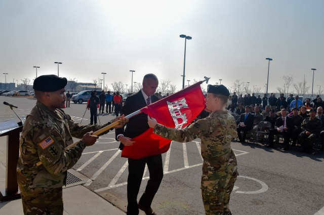 Col. Teresa Schlosser (right), U.S. Army Corps of Engineers (USACE), Far East District (FED) commander, and Richard Byrd, USACE FED Deputy District Engineer, unfurl the unit's colors during an uncasing ceremony held at the district's headquarters, Camp Humphreys, South Korea, Nov. 14.