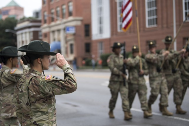 Staff Sgt. Abigail Ponce, Fort Jackson Drill Sergeant of the Year, salutes the national colors as the installation Color Guard marches past Nov. 12 during the Columbia 40th Annual Veterans Day Parade.