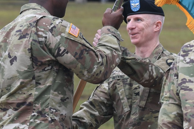 """Col. Brian T. Beckno, Leader Training Brigade commander, receives the unit colors from Brig. Gen. Milford """"Beags"""" Beagle Jr., during an assumption of command ceremony on Victory Field Nov. 8."""