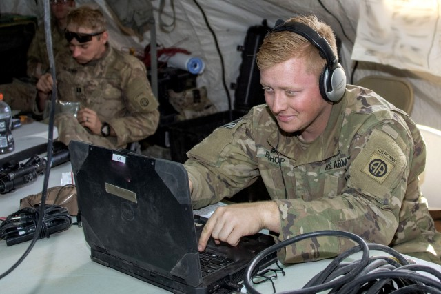 2nd Lt. Drew Bishop; a communications officer with the 5th Squadron, 73rd Cavalry Regiment, 3rd Brigade Combat Team, Airborne Division from Fort Bragg, N.C., monitors chat with the Command Post Computing Environment (CPCE) during Network Integration Evaluation (NIE) 18.2, Nov. 1 to 12 at Camp McGregor, N.M.
