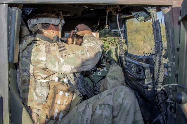 Spec. Bryant Torres, squadron commander driver for 5th Squadron, 73rd Cavalry Regiment, 3rd Brigade Combat Team, Airborne Division from Fort Bragg, N.C., monitors the location of friendly units with using the Mounted Computing Environment (MCE) during Network Integration Evaluation 18.2, Nov. 1 to 12 at Camp McGregor, N.M.