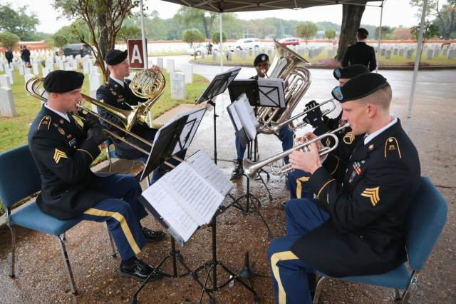 FORT BENNING, Ga. (Nov. 15, 2018) - An ensemble of the Maneuver Center of Excellence Band plays at the Fort Benning Main Post Cemetery. Soldiers, civilians, Family members and members of the community gathered under rainy weather for a German and Italian Memorial Day ceremony at the Main Post Cemetery here Nov. 14. Forty-four German and seven Italian service members of World War II are interred at the cemetery, and Soldiers of the Maneuver Center of Excellence lay wreaths to honor those service members annually. (U.S. Army photo by Markeith Horace, Maneuver Center of Excellence, Fort Benning Public Affairs)