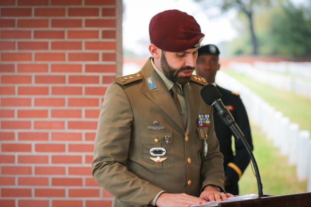 FORT BENNING, Ga. (Nov. 15, 2018) - Lt. Col. Corrado Carpentieri, Italian army liaison at Fort Benning, speaks during a German and Italian Memorial Day ceremony. Soldiers, civilians, Family members and members of the community gathered under rainy weather for a German and Italian Memorial Day ceremony at the Main Post Cemetery here Nov. 14. Forty-four German and seven Italian service members of World War II are interred at the cemetery, and Soldiers of the Maneuver Center of Excellence lay wreaths to honor those service members annually. (U.S. Army photo by Markeith Horace, Maneuver Center of Excellence, Fort Benning Public Affairs)