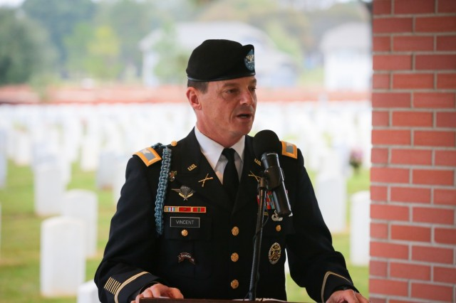 FORT BENNING, Ga. (Nov. 15, 2018) - Col. Douglas Soldiers, Col. Douglas G. Vincent, the chief of staff for the Maneuver Center of Excellence and Fort Benning, speaks about the World War II-era German and Italian prisoners of war who are interred at Fort Benning's Main Post Cemetery. civilians, Family members and members of the community gathered under rainy weather for a German and Italian Memorial Day ceremony at the Main Post Cemetery here Nov. 14. Forty-four German and seven Italian service members of World War II are interred at the cemetery, and Soldiers of the Maneuver Center of Excellence lay wreaths to honor those service members annually. (U.S. Army photo by Markeith Horace, Maneuver Center of Excellence, Fort Benning Public Affairs)