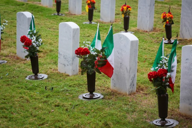 FORT BENNING, Ga. (Nov. 15, 2018) - Soldiers, civilians, Family members and members of the community gathered under rainy weather for a German and Italian Memorial Day ceremony at the Main Post Cemetery here Nov. 14. Forty-four German and seven Italian service members of World War II are interred at the cemetery, and Soldiers of the Maneuver Center of Excellence lay wreaths to honor those service members annually. (U.S. Army photo by Markeith Horace, Maneuver Center of Excellence, Fort Benning Public Affairs)