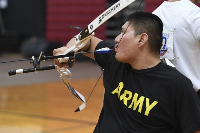 Spc. Kevin D. Holyan participated in the archery finals during the Pacific Regional Trials Nov. 13, 2018 at Schofield Barracks, Hawaii. The Pacific Regional Trials demonstrate the importance of the Warrior Care and Transition Program in the recovery and transition of wounded, ill and injured Soldiers. Adaptive reconditioning activities can be an integral part of a Soldier's Comprehensive Transition Plan and help to build resilience, strengthen relationships and improve self-confidence. (U.S. Army photo by Sgt. Dahnyce Baucom).