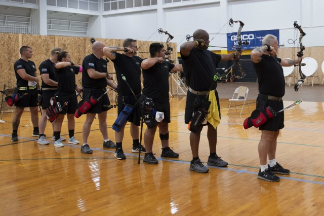 Service members participate in the archery finals during Pacific Regional Trials 2018 at Schofield Barracks, Hawaii, Nov. 13. These competitions take place during November, which also coincides with Warrior Care Month. During Warrior Care Month we focus on activities that allow us to communicate the Army's commitment to wounded, ill, and injured soldiers, their families, and caregivers, and to emphasize Warrior Transition Unit Soldiers' number one priority is to work as hard on their recovery as they work on defending the nation.
