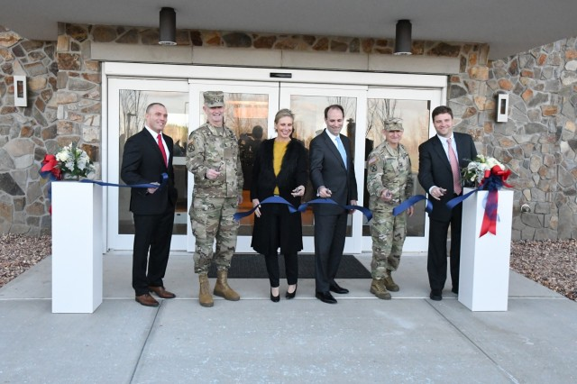 Chuck Sourbeer, IHG Army Hotels head of operations; Maj. Gen. Walter E. Piatt, 10th Mountain Division (LI) and Fort Drum commanding general; Claire Johnston, Lendlease Communities managing director; Jordan Gillis, acting assistant secretary of the Army for installations, energy and the environment; Col. Kenneth D. Harrison, Fort Drum garrison commander; and Kollin Rommel, Lendlease development manager; participate in the ribbon-cutting ceremony Nov. 14 for the grand opening of the Candlewood Suites hotel at Fort Drum. (Photo by Mike Strasser, Fort Drum Garrison Public Affairs)