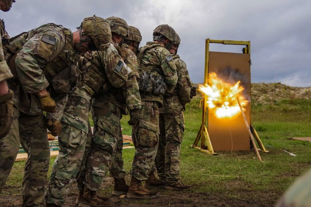 Paratroopers from 3rd Brigade Combat Team, 82nd Airborne Division, observe as a door-breaching charge detonates, Nov. 6, 2018, on Fort Bragg, N.C. Engineers conducted the demolitions training to keep their breaching skills current and ensure the battlefield mobility of the brigade's maneuver, reconnaissance and logistics elements.