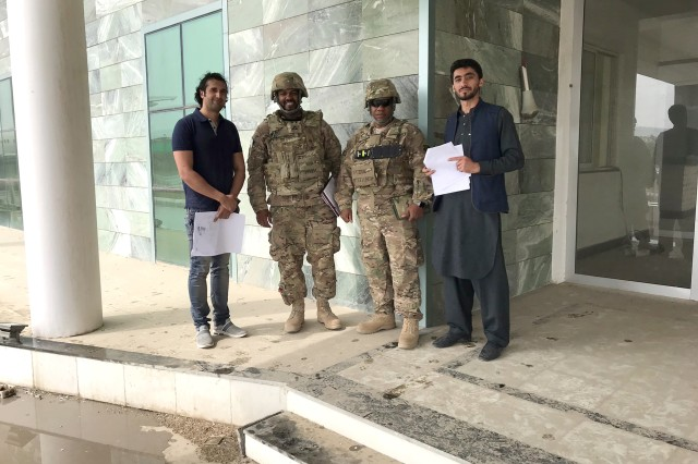 Pictured from left to right in uniform, Afghanistan District Project Manager Marshand Whittington (Baltimore District) and Deputy Chief for Programs and Project Management Lawrence Thomas (Memphis District) join Afghan nationals for a project site visit to Kandahar Air Field.