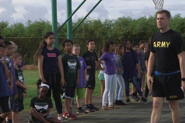 Capt. Weston Williams, 8th Special Troops Battalion, 8th Theater Sustainment Command, conducts a safety brief to the fifth grade class of the Gustav H. Webling Elementary School in Halawa, HI. Nov. 14, 2018.  The Children spent the morning playing several rounds of 'Sharks and Trees' as part of their morning Physical Education hour.