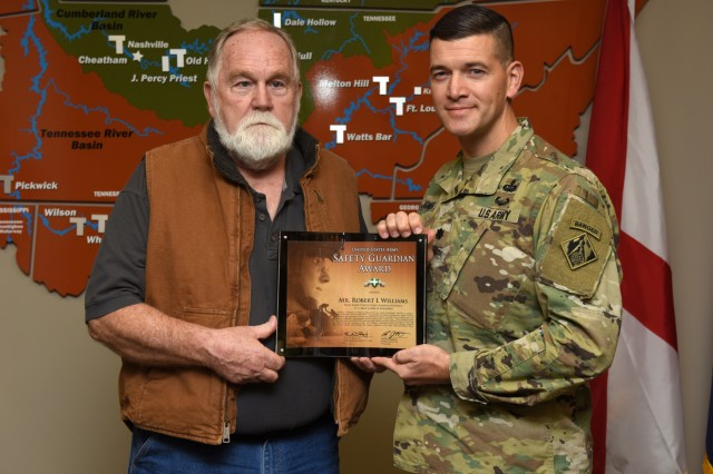 Lt. Col. Cullen Jones, U.S. Army Corps of Engineers Nashville District commander, presents the United States Army Safety Guardian Award to Robert Williams, Wolf Creek Dam Power Plant shift operator, during a ceremony Nov. 15, 2018 at the Nashville District Headquarters in Nashville, Tenn. Williams is one of five employees whose quick actions to evacuate an injured contractor from a confined space July 9, 2018 at Wolf Creek Dam in Jamestown, Ky., reduced the time it took for the victim to receive life-saving medical treatment. (USACE photo by Leon Roberts)