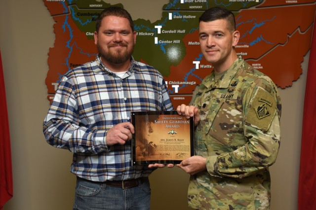 Lt. Col. Cullen Jones, U.S. Army Corps of Engineers Nashville District commander, presents the United States Army Safety Guardian Award to James Riley, Wolf Creek Dam Power Plant operator trainee, during a ceremony Nov. 15, 2018 at the Nashville District Headquarters in Nashville, Tenn. Riley is one of five employees whose quick actions to evacuate an injured contractor from a confined space July 9, 2018 at Wolf Creek Dam in Jamestown, Ky., reduced the time it took for the victim to receive life-saving medical treatment. (USACE photo by Leon Roberts)