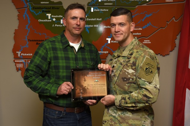 Lt. Col. Cullen Jones, U.S. Army Corps of Engineers Nashville District commander, presents the United States Army Safety Guardian Award to Eric Todd McGowan, Power Plant maintenance worker, during a ceremony Nov. 15, 2018 at the Nashville District Headquarters in Nashville, Tenn. McGowan is one of five employees whose quick actions to evacuate an injured contractor from a confined space July 9, 2018 at Wolf Creek Dam in Jamestown, Ky., reduced the time it took for the victim to receive life-saving medical treatment. (USACE photo by Leon Roberts)