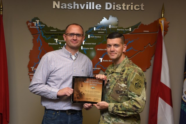 Lt. Col. Cullen Jones, U.S. Army Corps of Engineers Nashville District commander, presents the United States Army Safety Guardian Award to Anthony Watters, Wolf Creek Dam Power Plant superintendent, during a ceremony Nov. 15, 2018 at the Nashville District Headquarters in Nashville, Tenn. Watters is one of five employees whose quick actions to evacuate an injured contractor from a confined space July 9, 2018 at Wolf Creek Dam in Jamestown, Ky., reduced the time it took for the victim to receive life-saving medical treatment. (USACE photo by Leon Roberts)