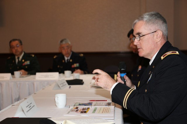 Col. Marvin Emerson, commander of U.S. Army Medical Department Activity - Japan, asks Japan Ground Self-Defense Force senior medical officers questions on their medical systems Nov. 14 at the Camp Zama Community Club during the annual bilateral medical conference hosted by MEDDAC-Japan. (U.S. Army photo by Noriko Kudo, U.S. Army Garrison Japan Public Affairs)