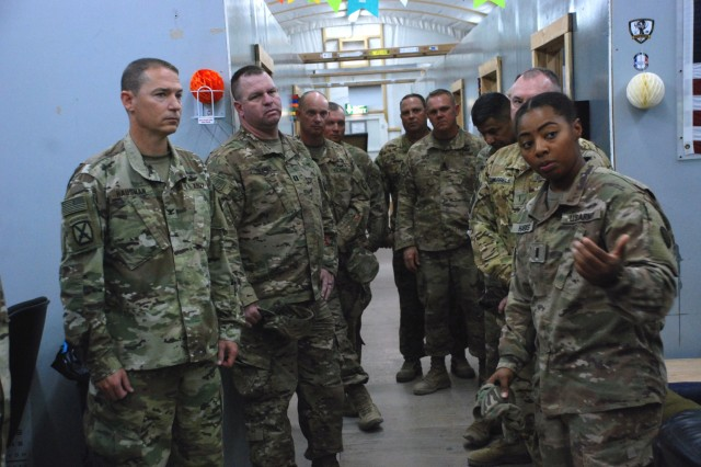 U.S. Army National Guard Col. Charles Hausman, 35th Combat Aviation Brigade commander, left, receives a briefing from 1st Lt. Amber Harris, 935th Aviation Support Battalion field medical assistant, at Camp Buehring, Kuwait, Oct. 6, 2018.  Hausman was visiting Soldiers of the 935th ASB during their deployment in support of Operations Inherent Resolve and Spartan Shield.  (U.S. Army National Guard photo by Sgt. Billie Thompson)