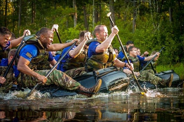 Paratroopers compete against each other during the 307th Airborne Engineer Battalion's commemoration of the 74th anniversary of the Waal River Crossing, Oct. 3, 2018, at Fort Bragg, N.C. The paratroopers were competing to cross the lake five times in honor of Pfc. Willard Jenkins, killed by enemy fire while manning a rudder during the WWII river assault.